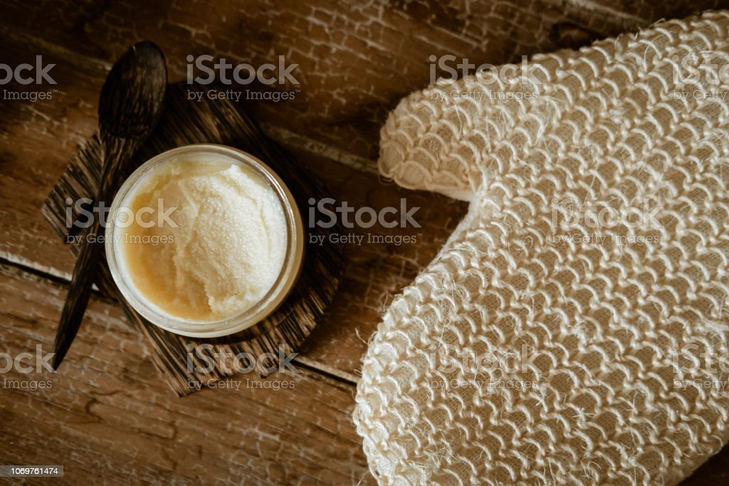 Natural SPA cosmetics on wooden table from above. Warm toned filter....