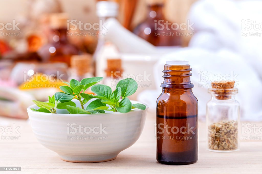 Natural Spa Ingredients essential oil with oregano leaves for ar stock photo