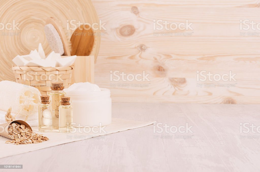 Natural Spa Massage Oil And Cosmetics Products Bath Accessories With Bamboo Decor On Beige Wood Board Interior Stock Photo Download Image Now Istock