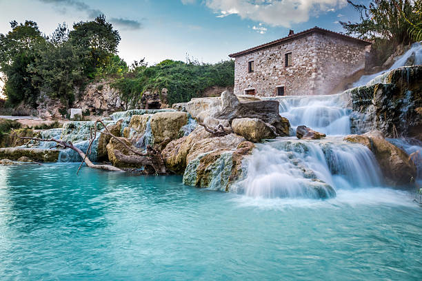 natural spa with waterfalls in tuscany, italy - hot spring stock photos and pictures