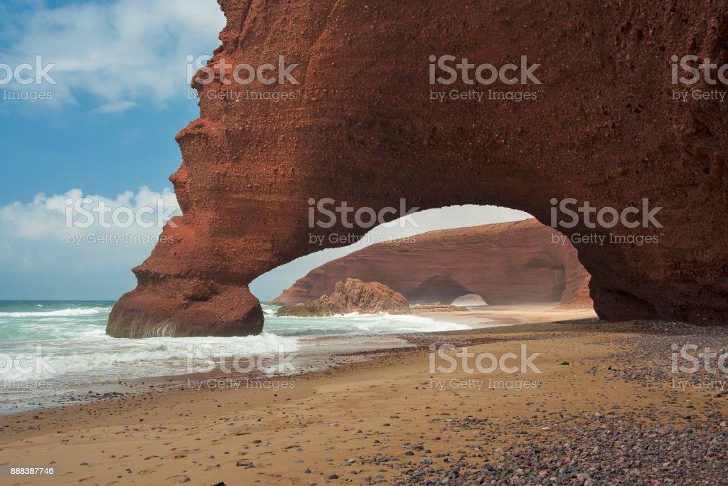 Natural stone arches on Atlantic shore. Legzira, Morocco stock photo