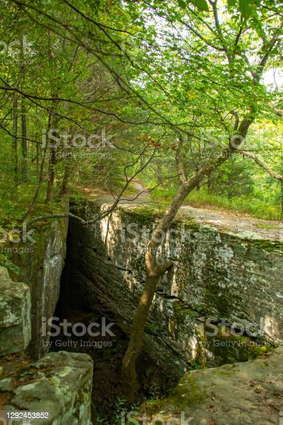 Photo of Natural stone bridge on the hiking trail at Bell Smith Springs, Shawnee National forest, Illinois.