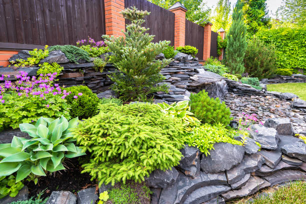 Natural stone landscaping in backyard in summer stock photo
