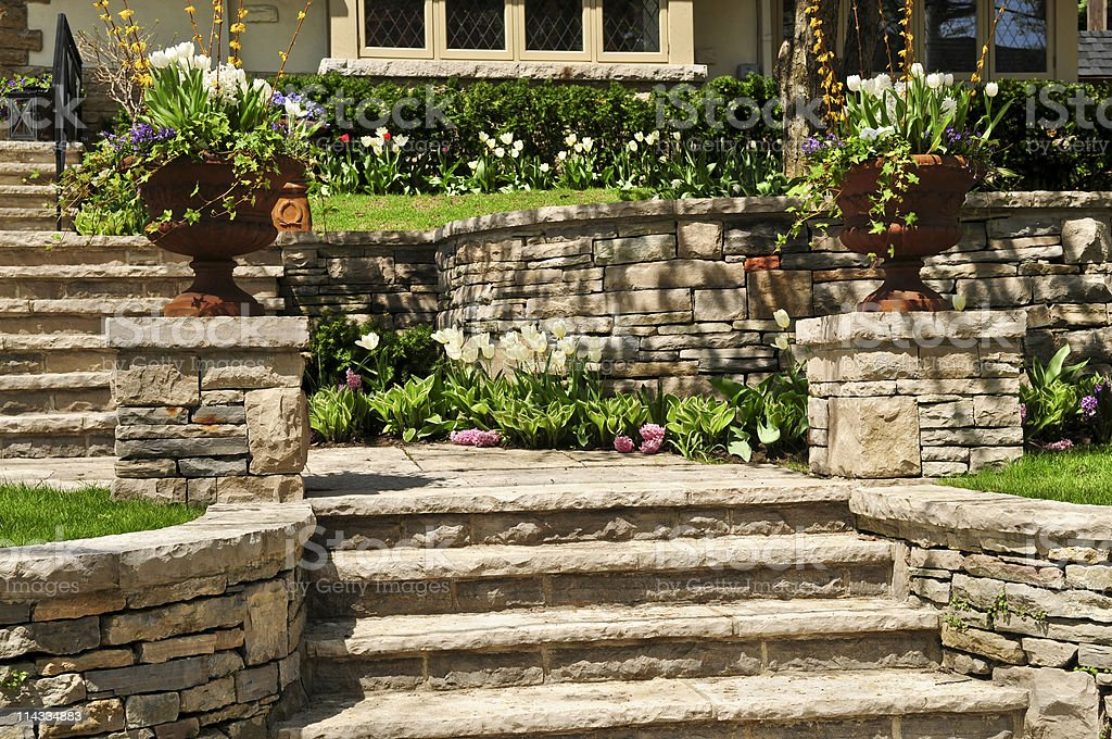 Natural stone landscaping of walls and steps outside house stock photo