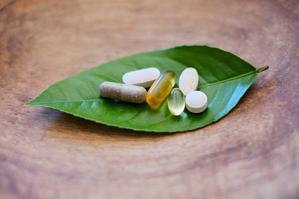 natürliche und zusatzpräparate - nahrungsergänzungsmittel stock-fotos und bilder