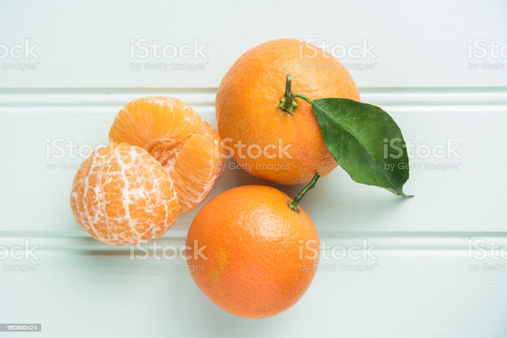 Natural sweet clementines on rustic table from above - Royalty-free Bowl Stock Photo
