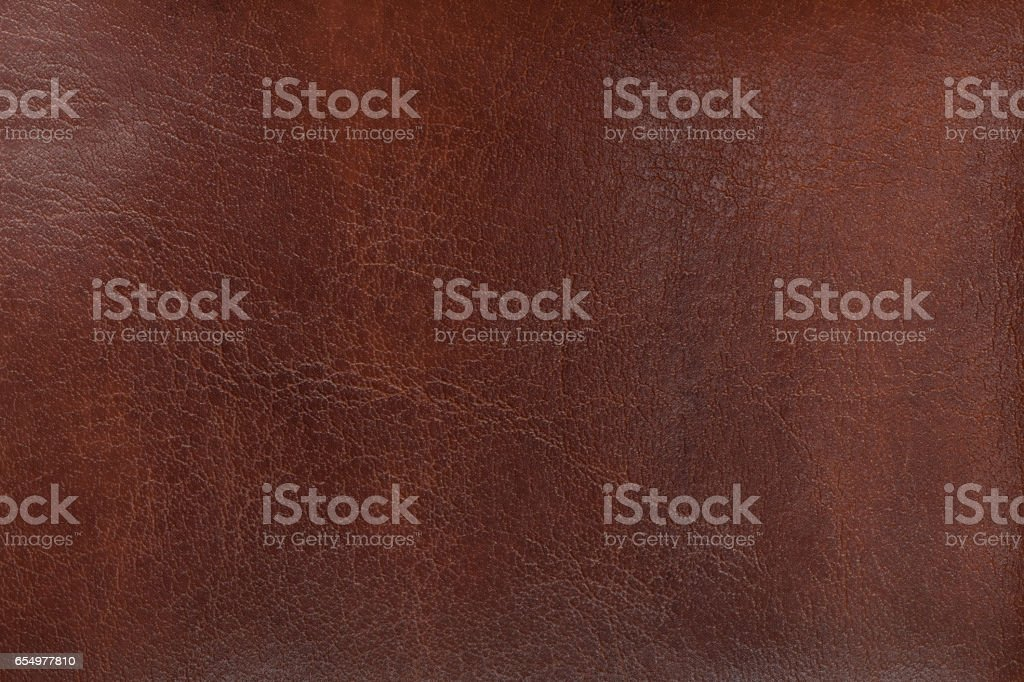 Natural texture aged brown leather. Closeup. stock photo
