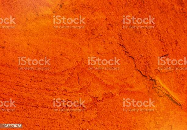 Photo of natural texture of a cracked red ocher wall