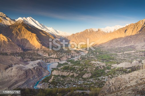 Natural view along Karakorum mountains at Hunza valley with Cherry blossom autumn season Pakistan