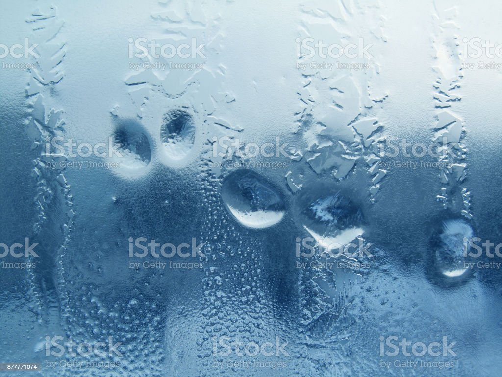 natural water drops and frost on winter glass stock photo