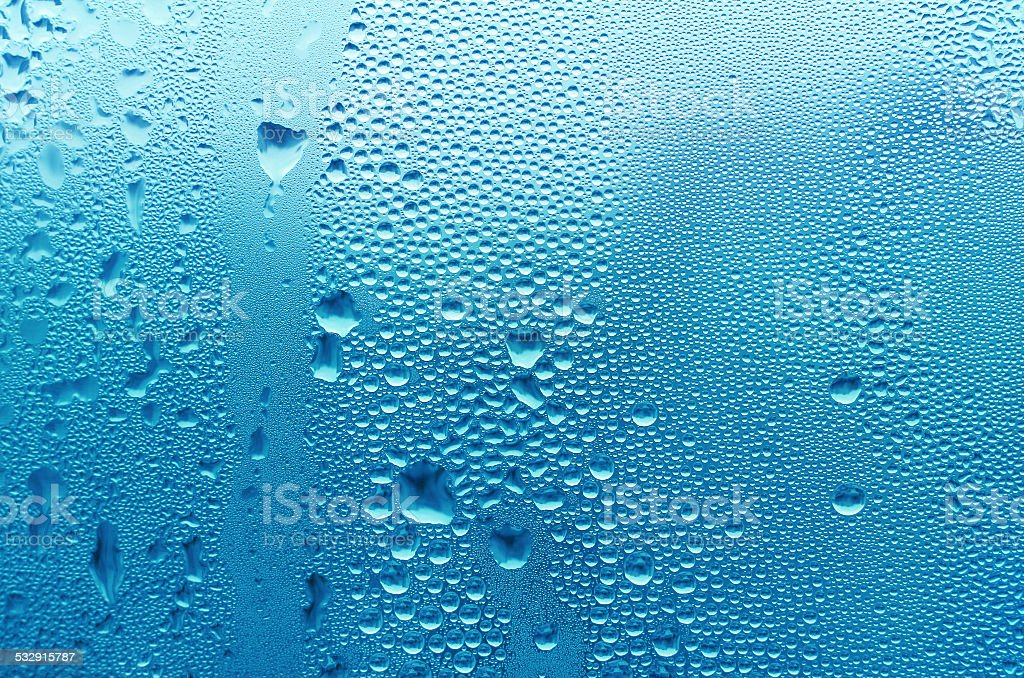 Natural water drops on glass stock photo