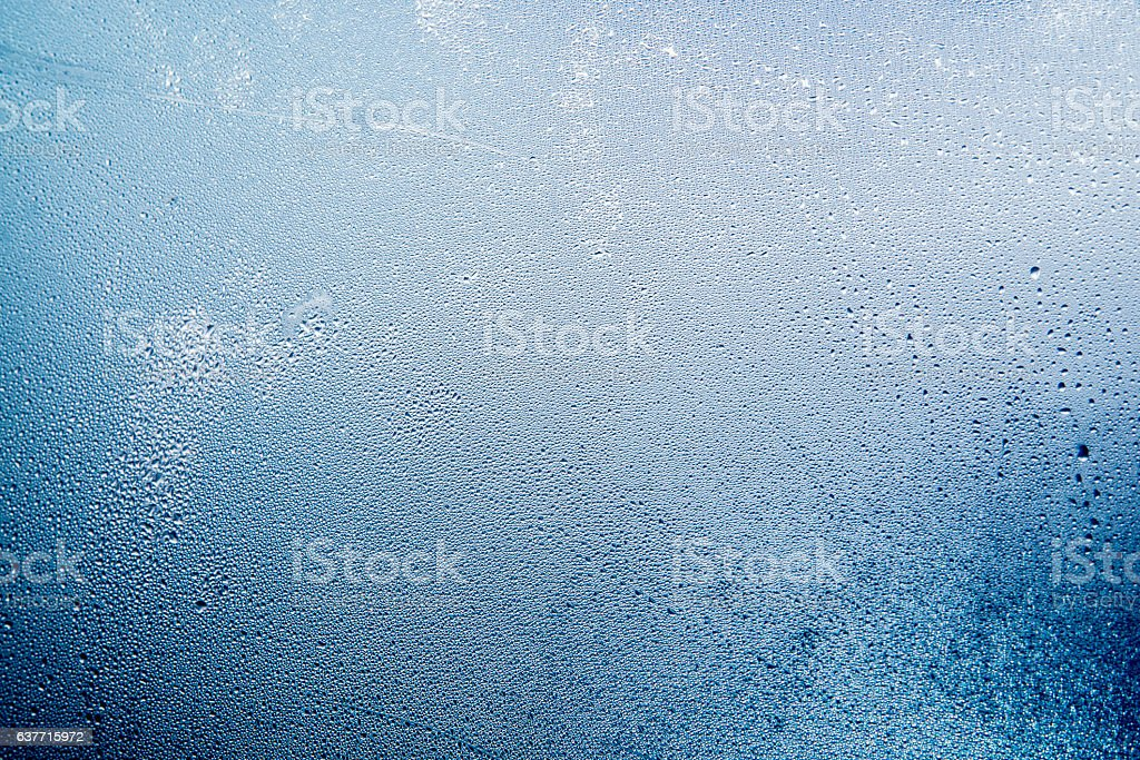 Natural water drops on glass, winter condensation stock photo
