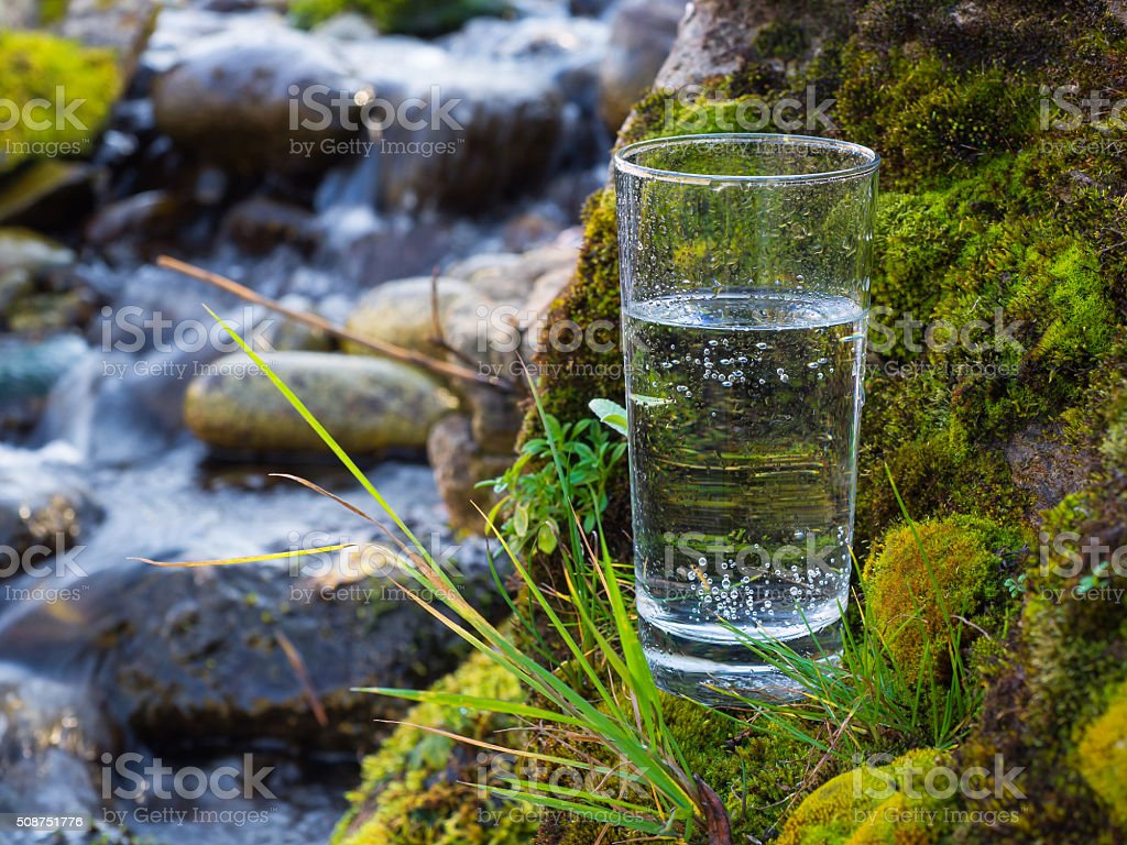 Natural water in a glass stock photo