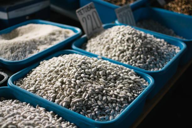 Natural white beans on the market stock photo