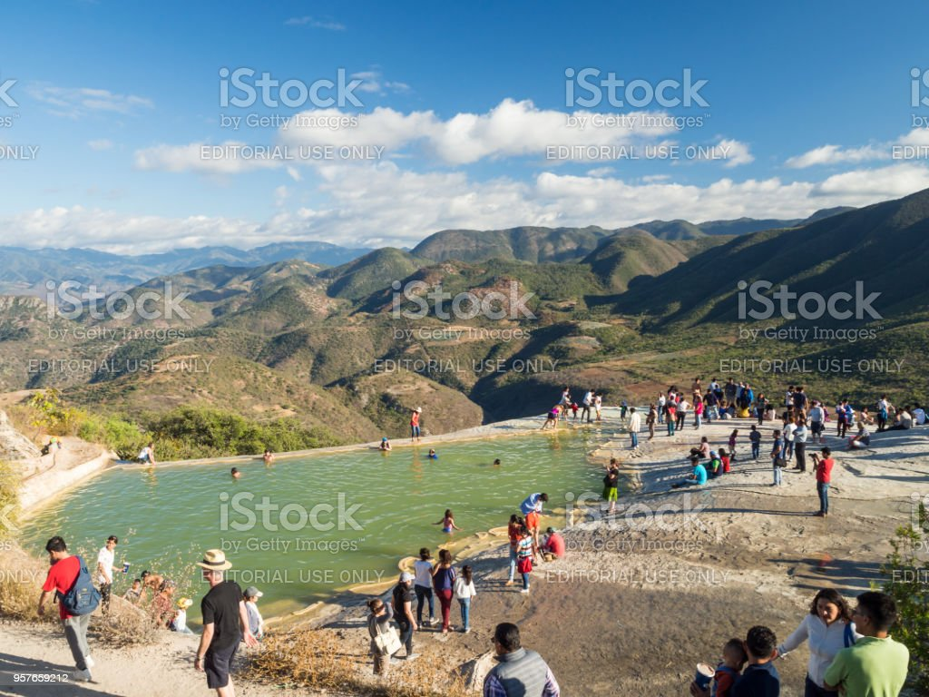 Hierve el agua, Oaxaca, Mexico, South America - January 2018: [natural wonder formation in Oaxaca region, hot spring waterfall in the mountains during sunset] stock photo