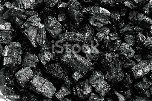 istock Natural wood charcoal, traditional charcoal or hard wood charcoal, Used as fuel for industrial coal. 917125894