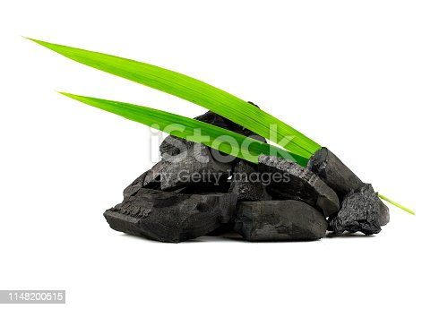 Natural wood charcoal,Bamboo charcoal powder has medicinal properties with traditional charcoal isolated on white background