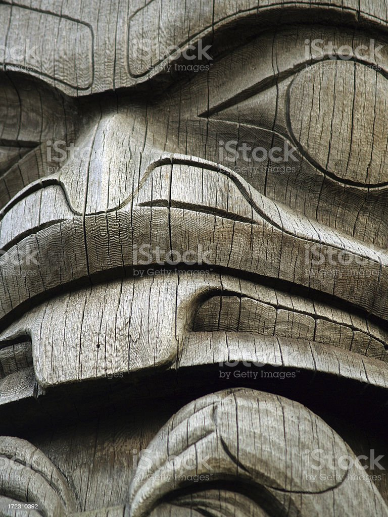 Natural wood totem, close-up detail stock photo