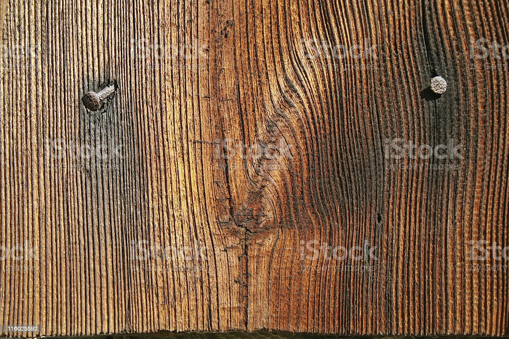 Natural wooden wall and nails royalty-free stock photo