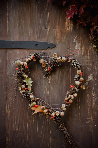 Natural wreath in form of heart on the brown door stock photo