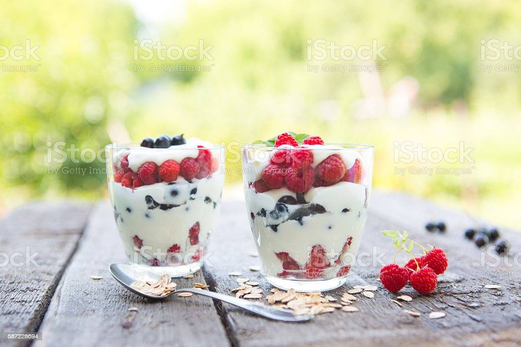Natural yogurt with fresh raspberries, black currant and muesli. stock photo
