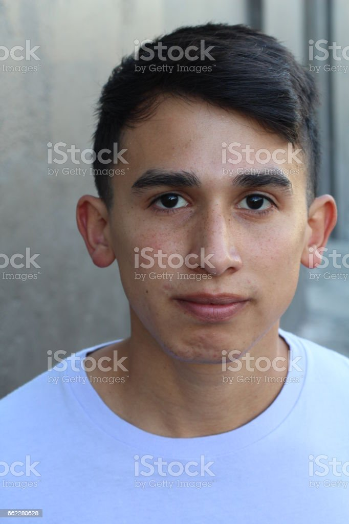 Natural young hispanic man close up stock photo