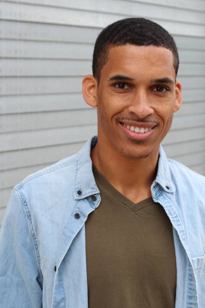 Natural young man smiling close up Natural young man smiling close up. afro caribbean ethnicity stock pictures, royalty-free photos & images