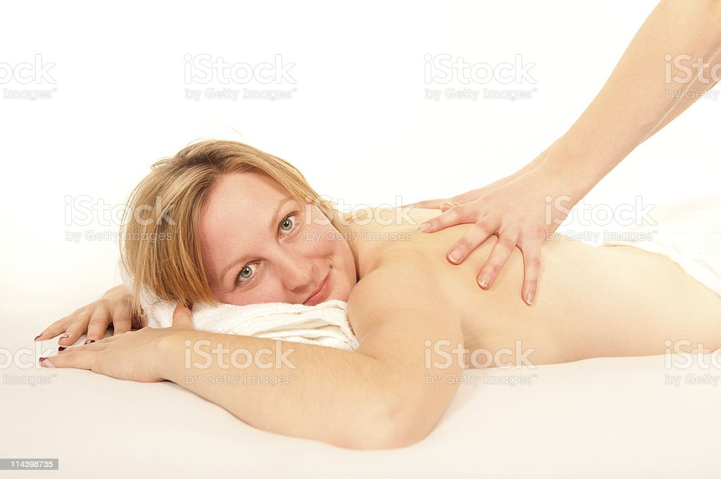 Natural young woman receiving a massage royalty-free stock photo