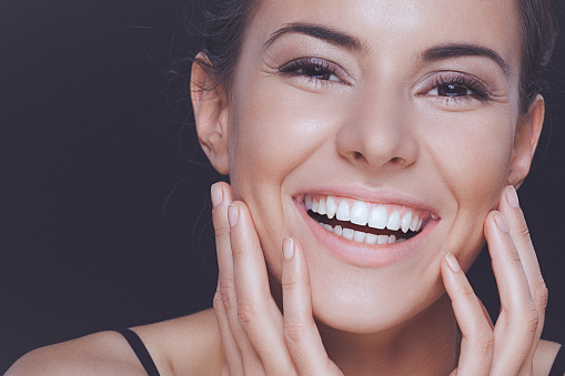 Natural young woman with perfect smile and clean healthy skin stock photo