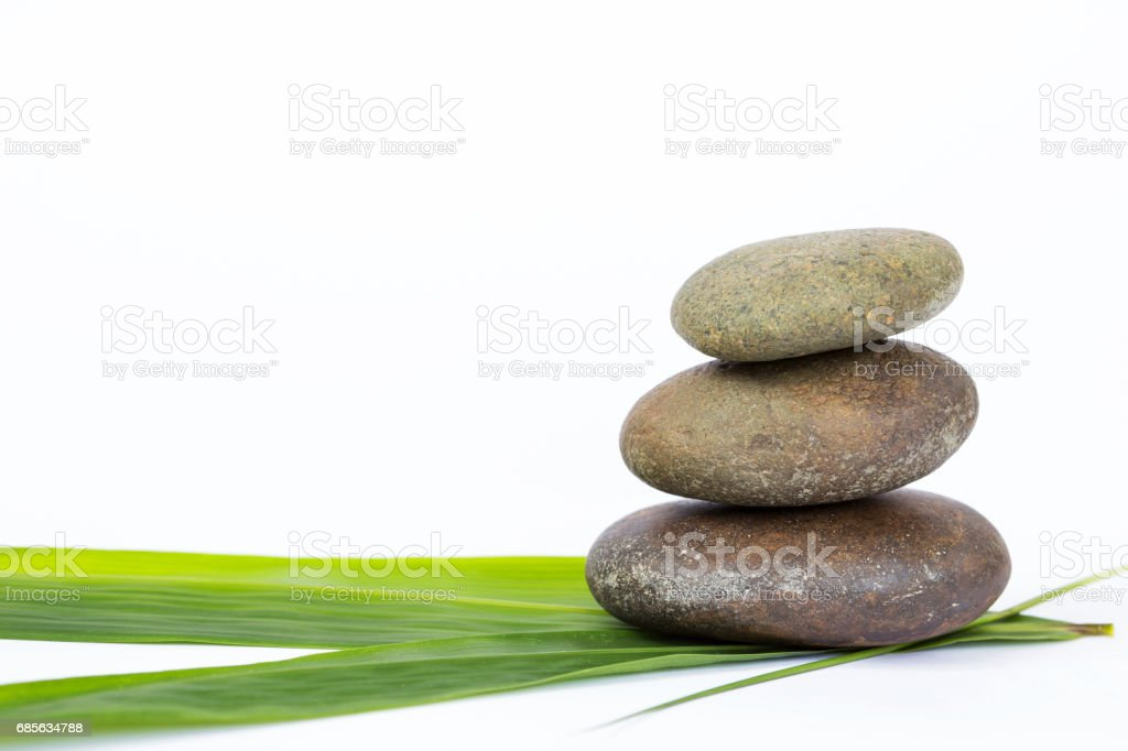 Natural zen stone on fresh green bamboo leaf royalty-free 스톡 사진