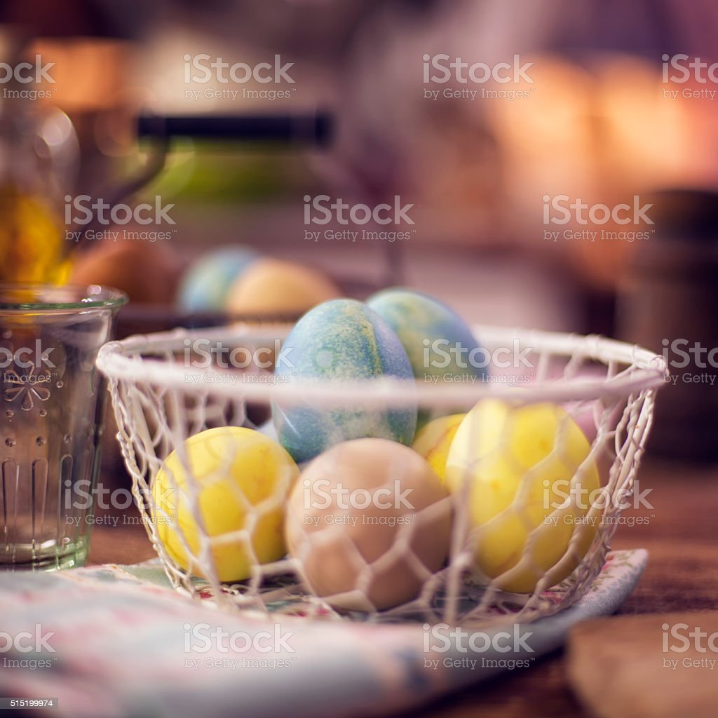 Naturally dyed Easter eggs in a basket. The eggs are dyed with...