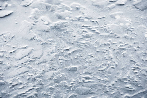 Naturally textured frozen water background stock photo