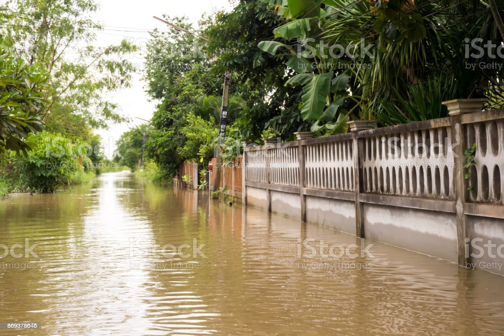 Nature and disaster background. Flooding in town. Flooding over road. stock photo