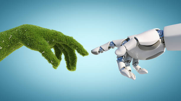 Nature and technology abstract concept, robot hand and natural hand covered with grass stock photo