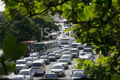 salvador, bahia / brazil - august 23, 2013: Trees try to hide the congestion at Avenida Tancredo Neves in the city of Salvador.
