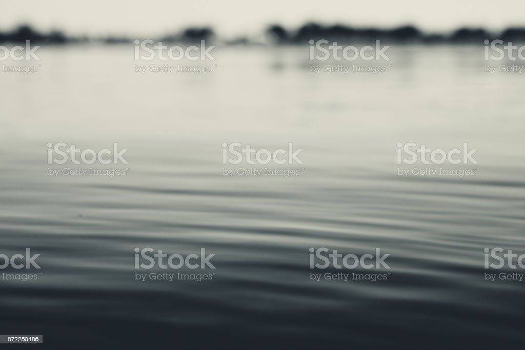 Nature Background - Flowing Water With Distant Shoreline stock photo