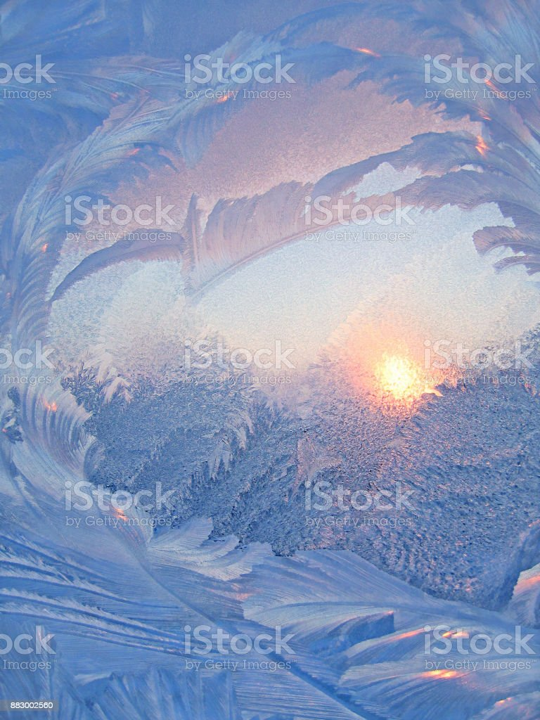 Nature background with ice pattern and sunlight on glass stock photo