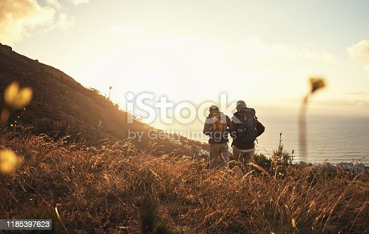 Shot of a couple going for a hike up the mountain