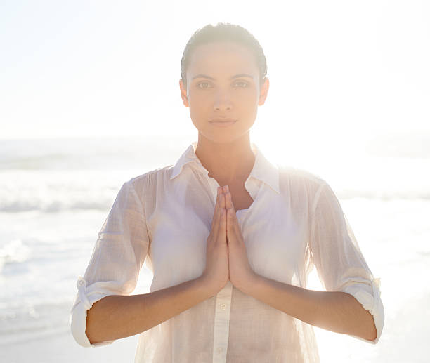 Nature helps me find peace A beautiful young woman meditating outside prayer pose yoga stock pictures, royalty-free photos & images