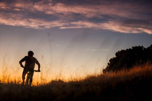 nature inspiration man mountain biking stock photo