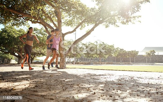 Shot of a small group of three people out for a run together