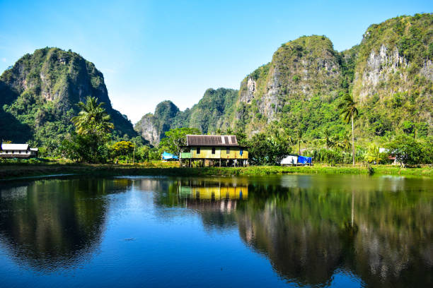 Nature Landscape 4 Lake surrounded by mountains of rocks sulawesi stock pictures, royalty-free photos & images