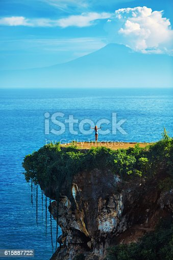 istock Nature Landscape. Woman On Tropical Cliff, Sea Rock On Island 615887722