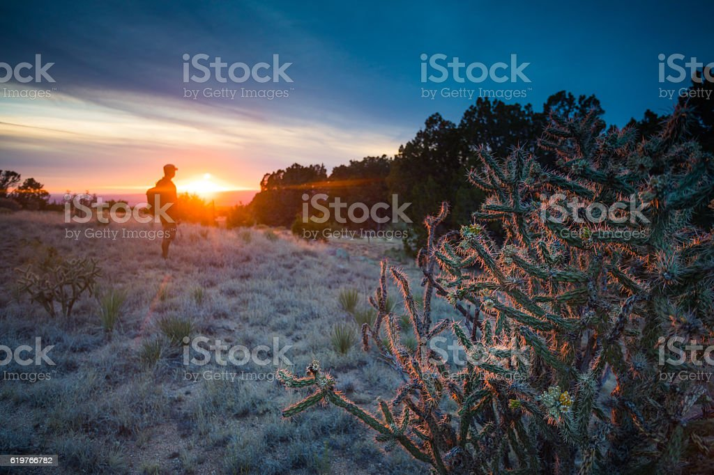 nature man dramatic landscape sunlight stock photo