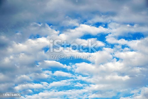 istock Nature Mostly White Clouds and Blue Sky Texture Background - blue and white abstract 1326744870