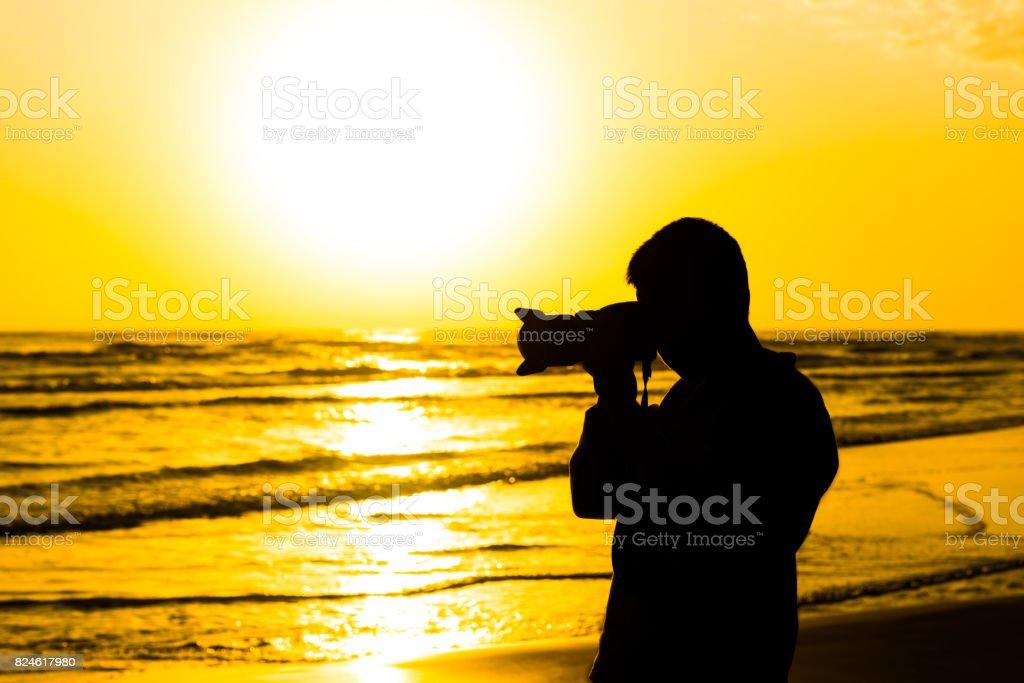 Natur-Fotograf am Meer – Foto