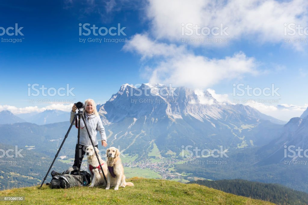 Nature photographer enjoy the view her dogs, Zugspitze, Alps stock photo