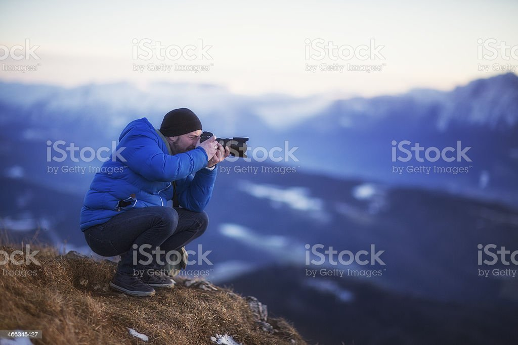 Nature photographer in the Mountain stock photo
