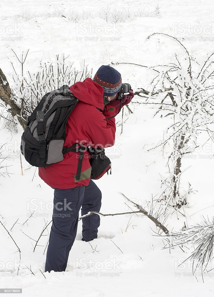 Nature photographer in the snow royalty-free stock photo