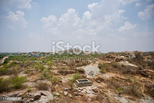 High Vantage point of natural sandstone rock formation in South India with horizon in the background